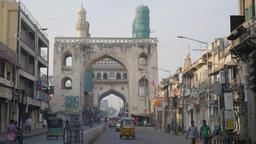 Traffic through gate to Charminar,Hyderabad,India Footage