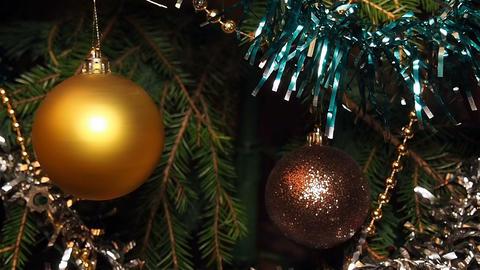 Christmas Ball on a Branch. Flashing Garland And Christmas Tinsel Footage