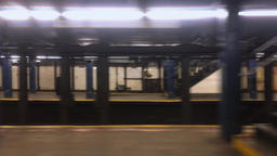 Profile View of Subway Leaving Manhattan Station Footage