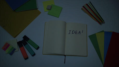 Brightening up word Idea written on note pad Footage