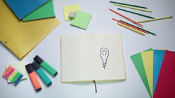 Bright idea concept appearing on white note pad ภาพวิดีโอ