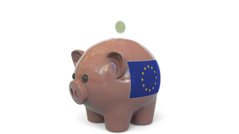 Putting money into piggy bank with flag of the European Union. EU banking system Live Action