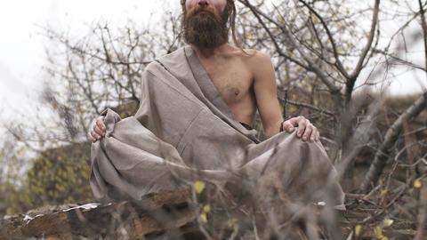 Ascetic yogi meditating in mountains Footage