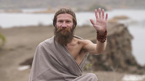 Ascetic sadhu blesses raising his hand up ビデオ