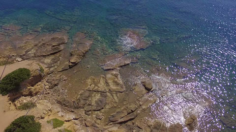 Aerial bird view of beautiful coast with rocks in blue and turquoise crystal clear sea Footage