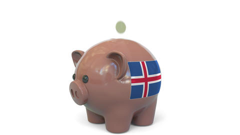 Putting money into piggy bank with flag of Iceland. Tax system system or savings Live Action