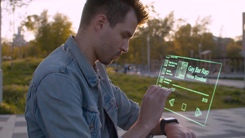 Man in the city park using futuristic device Footage