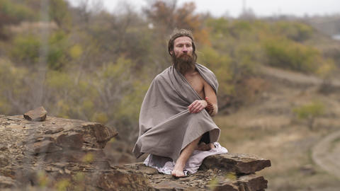 Hindu asket resting on nature Footage