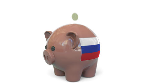 Putting money into piggy bank with flag of Russia. Tax system system or savings Live Action