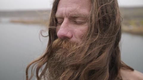 Ascetic yogi meditates on nature ビデオ