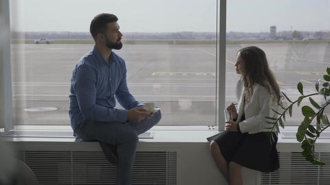 Adult Caucasian man and little girl sitting at the airport windowsill and Footage