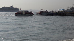 Life boats of cruise liner transportation tourists from ship, forth in sea port Footage