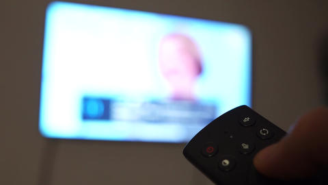 Male hand holding the Smart TV remote control RC. Channel surfing. Internet TV ビデオ
