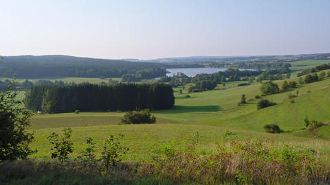 Panoramic view of pond named River and surrounding meadows and woods Live Action