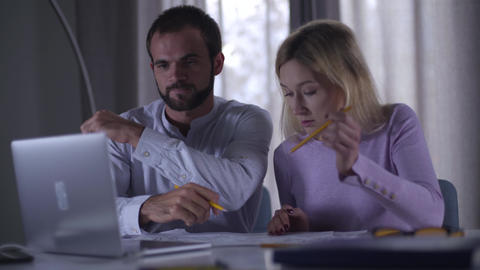 Confident adult Caucasian man reaching agreement with his pretty female coworker Footage
