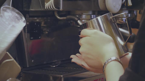 Barista whips the milk in coffee machine GIF