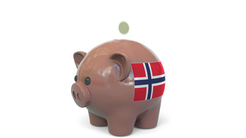 Putting money into piggy bank with flag of Norway. Tax system system or savings Live Action