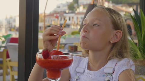 Portrait teenager girl drinking strawberry cocktail by straw in outdoor summer Footage