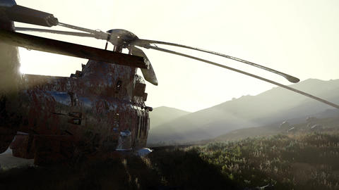 old rusted military helicopter in the desert at sunset Archivo
