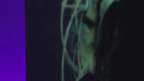 Teen girl is dancing in nightclub in front of vj wall Footage