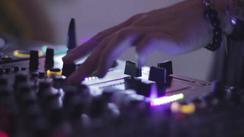 Hands of female Dj tweak and move turntable and mixer in the nightclub Footage
