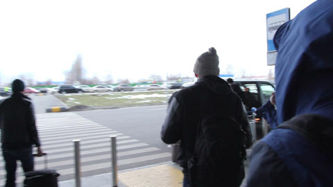 Airport to taxi walkthrough, people carrying bags. Airplane taxi Footage