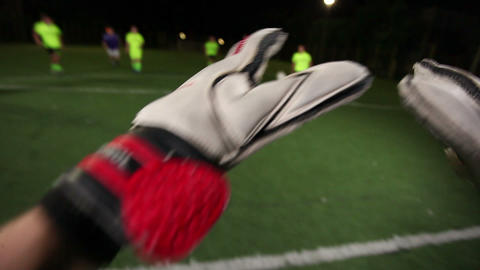 Soccer goalkeeper save (punch). POV of keeper. Football youth playing Footage