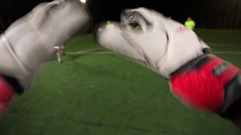 Goalkeeper POV. Saving a goal with a punch in a soccer (football) game Footage