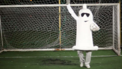 Crazy condom man in costume acting as a goalkeeper saving goal Footage