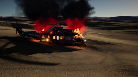 burned military helicopter in the desert at sunset Archivo