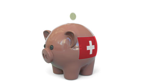 Putting money into piggy bank with flag of Switzerland. Tax system system or Live Action