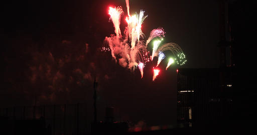 Fireworks near the building at the urban city in Tokyo at summer night long shot Footage
