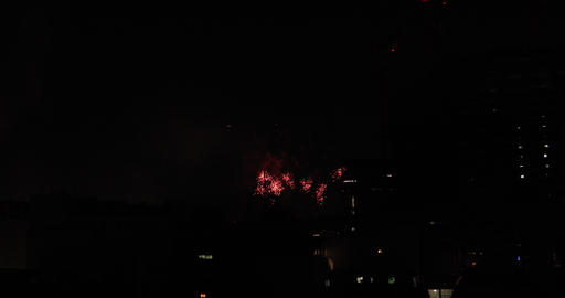 Fireworks near the building at the urban city in Tokyo at summer night wide shot ライブ動画