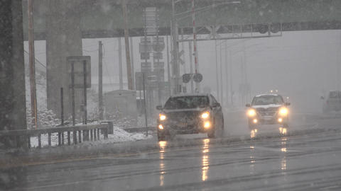 Traffic Under Bridge During Snow Storm Live Action
