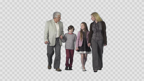 Children, mother and grandfather are walking, holding hands. Alpha channel Live Action