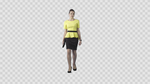 Beautiful girl in yellow is slowly strolling at the camera. Background in alpha Footage