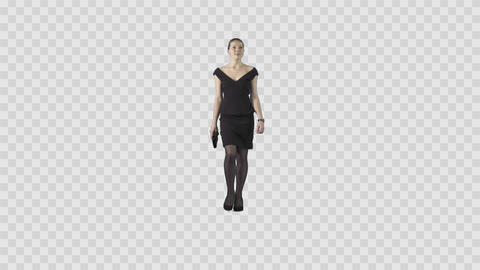 Elegant young woman in black short formal dress is walking at the camera Footage