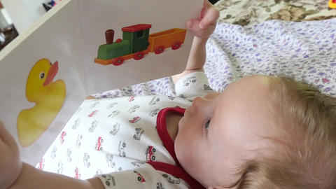Baby Playing With Story Book Footage
