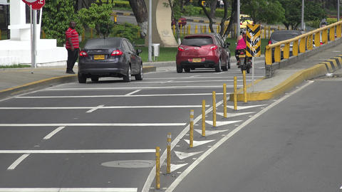 Pedestrian Crosses Street Traffic Footage