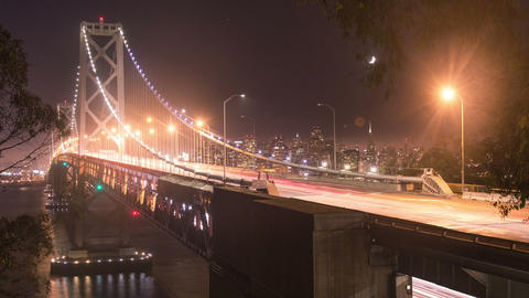 Time lapse - San Francisco, Bay Bridge at night with moving traffic Footage