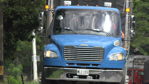 Blue Tractor Trailer on Rural Highway Footage