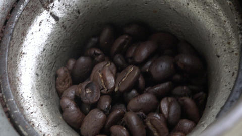 Coffee Beans in Hand Operated Grinder Live Action