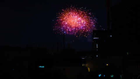 A timelapse of fireworks near the building at the urban city in Tokyo at summer Footage