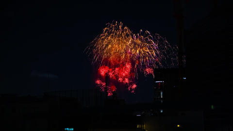 A timelapse of fireworks near the building at the urban city in Tokyo at summer ビデオ