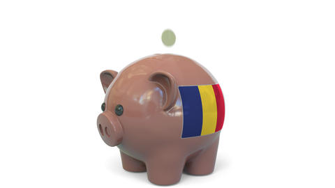 Putting money into piggy bank with flag of Romania. Tax system system or savings Live Action