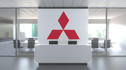 MITSUBISHI logo above reception desk in the modern office, editorial conceptual Live Action