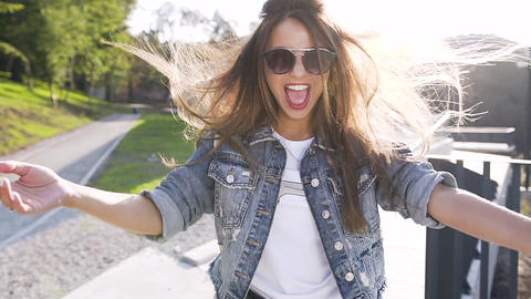Close up of face of attractive brunette, smiling funny woman while walking in Footage