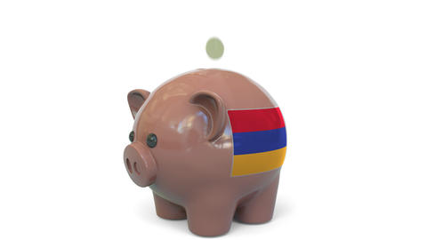 Putting money into piggy bank with flag of Armenia. Tax system system or savings Live Action
