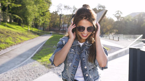 Portrait of pretty young smiling and happy woman in sunglasses with long hair Footage