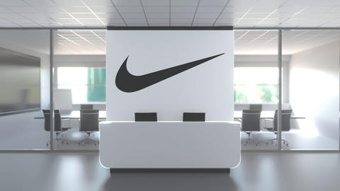 NIKE logo above reception desk in the modern office, editorial conceptual 3D Live Action